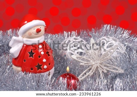 Christmas decoration, Santa Claus and colorful flare of light - stock photo
