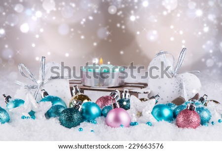 Christmas decoration, sledge, balls on snow with abstract background - stock photo