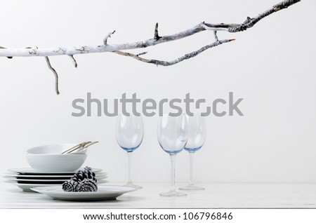 Christmas decoration table display in silver frosty icy tone, simple minimalist elegant design - stock photo