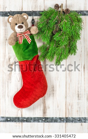 Christmas decoration. Teddy Bear and Red Sock stocking. Vintage style ornaments
