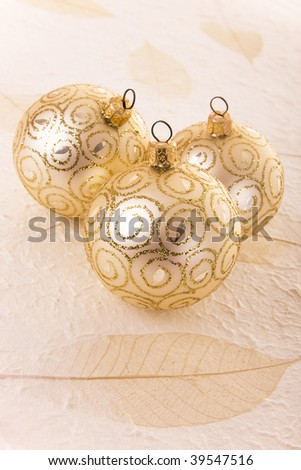 Christmas decoration: Three elegant golden baubles