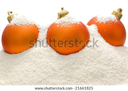 Christmas decoration, Three orange balls in snow - stock photo