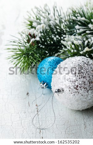 Christmas decoration with Balls and Fir branch on textured background - stock photo