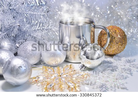 Christmas decoration with balls, tree and a cup of hot coffee - stock photo