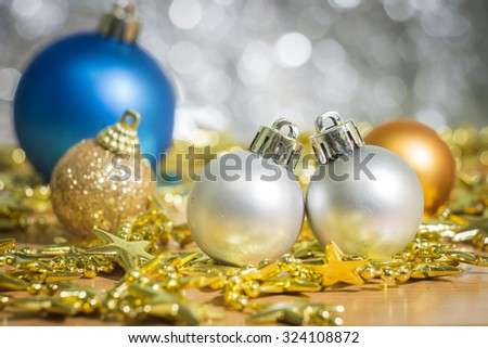 Christmas decoration with bauble ball on wooden table over lights background, selective focus, rustic style  - stock photo