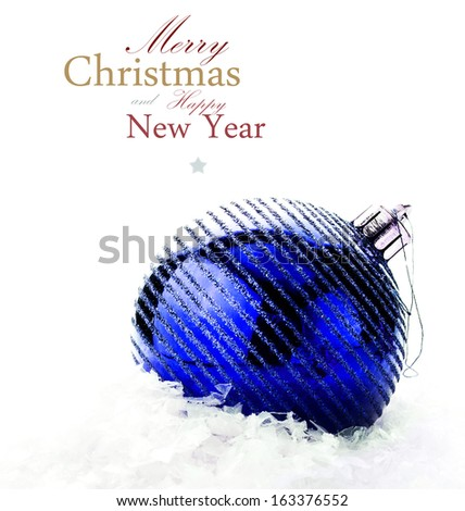 Christmas decoration with  big blue bauble and snow  (with easy removable sample text) - stock photo