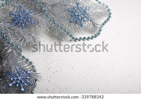 Christmas decoration with blue snowflakes and chain.  - stock photo