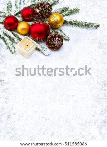 Christmas decoration with branch of christmas tree, cone pine, Christmas toys and candle on snow on background of frosty pattern with space for text. Top view, flat lay