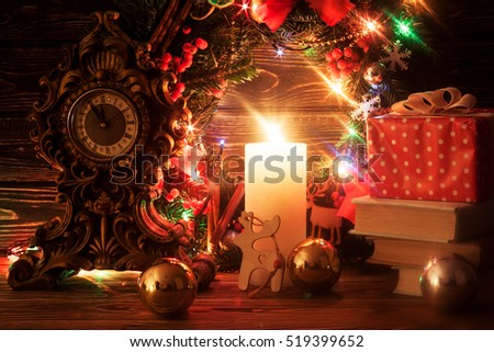 Christmas decoration with candle. Light garland. Greeting card