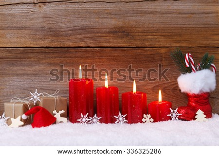 christmas decoration with candles for advent season four candles burning - stock photo