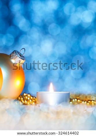 Christmas decoration with christmas balls and candlelight - stock photo