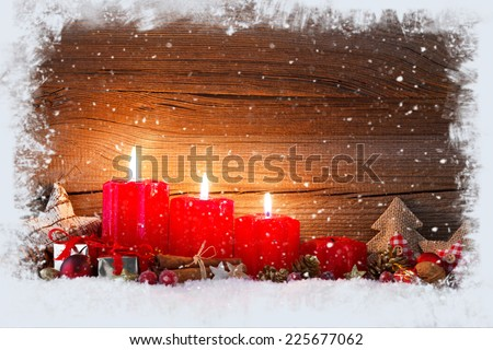 christmas decoration with christmas bauble and candle for advent season three candles burning - stock photo
