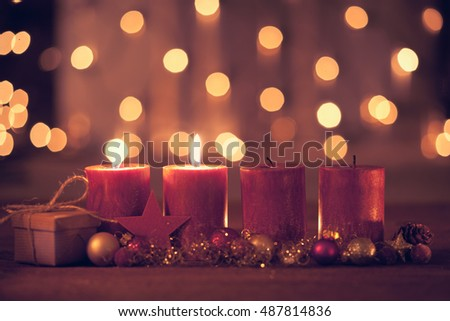 christmas decoration with christmas bauble and candle for advent season two candles burning