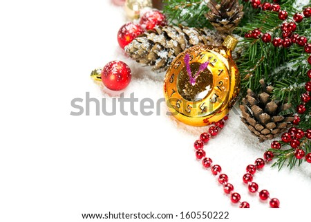 Christmas decoration with clock toy over white - stock photo