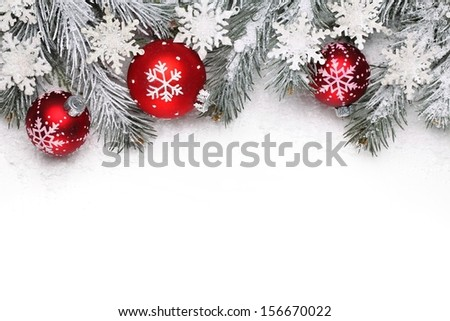 Christmas decoration with fir branch, Christmas ball and snow - stock photo