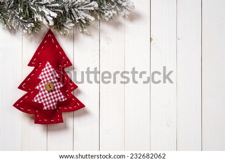 Christmas decoration with fir branches on the background of a tree with copy space - stock photo