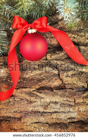 Christmas decoration with fir branches on the wooden background - stock photo