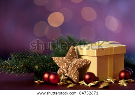 christmas decoration with gift and lights in background - stock photo