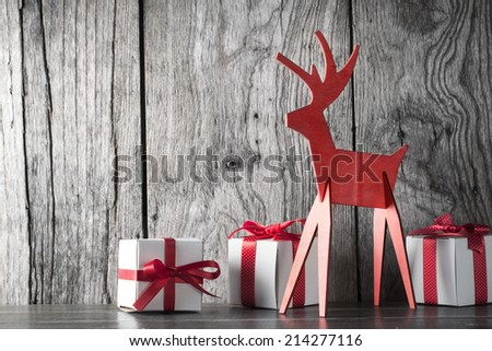 Christmas decoration with gift box on wood background - stock photo