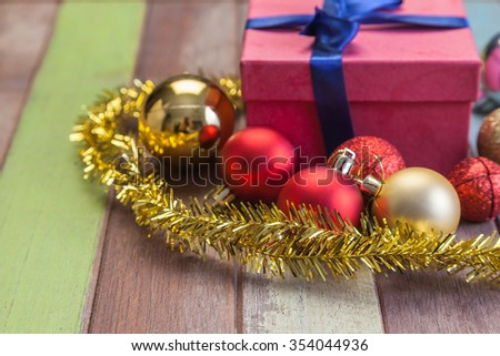 Christmas decoration with gift box on wooden background - stock photo