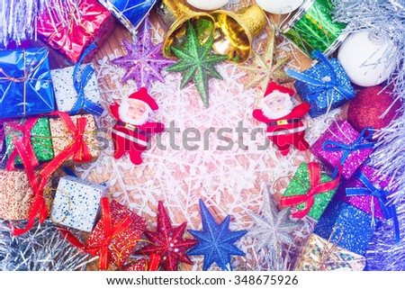Christmas decoration with gifts and Santa doll on wooden background - stock photo