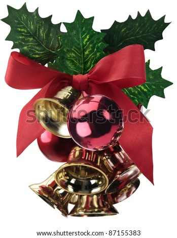 Christmas decoration with green leaves, red balls, bells, and gold ribbon, isolated on white. - stock photo