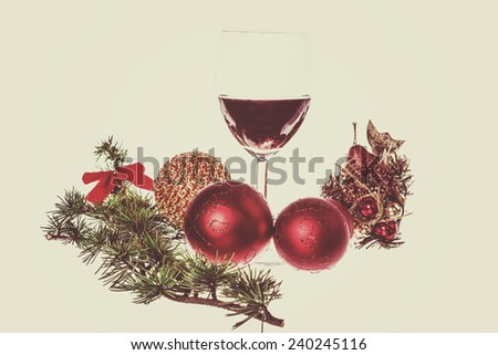 Christmas decoration with green pine and blue snow round ball ornaments for Christmas tree with glass wine. Holiday decorations isolated on white vintage retro background. Empty space for greeting card - stock photo