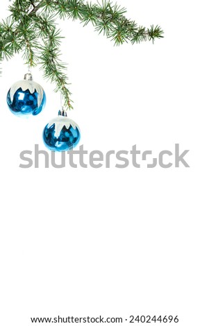 Christmas decoration with green pine or fir and blue snow round ball ornaments for Christmas tree. Holiday decorations isolated on white background. Empty or copy space for holiday greeting card - stock photo