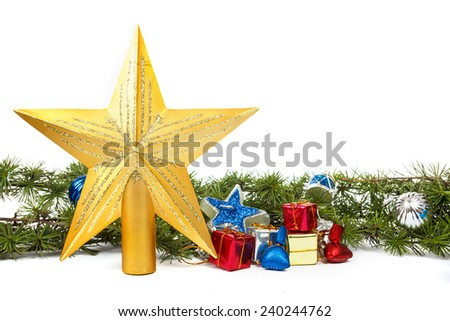 Christmas decoration with green pine or fir and many gifts and gold star for Christmas tree. Holiday decorations isolated on white background. Empty or copy space for holiday greeting card - stock photo