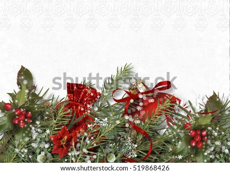 Christmas decoration with holly and poinsettia on white paper