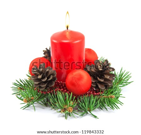 Christmas decoration with red candle, pine cones, spruce branches on white background - stock photo
