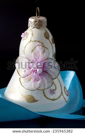 Christmas decoration  with ribbon on black background - stock photo