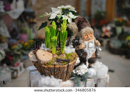 Christmas decoration with Santa Claus and flowers