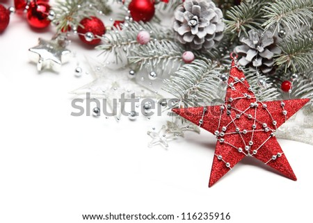 Christmas decoration with star and frosty branch. - stock photo