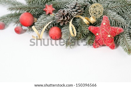 Christmas decoration with the twigs of the spruce and baubles - stock photo
