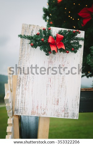Christmas decoration with vintage film filter,shallow Depth of Field,Focus on white wood.