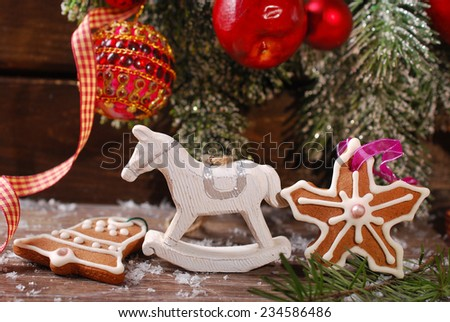 christmas decoration with vintage rocking horse toy on  wooden background - stock photo