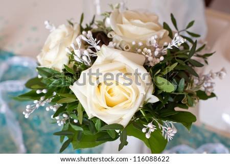 Christmas decoration with white roses and  turquoise cloth - stock photo