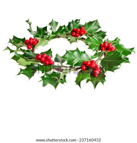Christmas decoration wreath of natural leaves and berries holly ilex plant isolated on white background - stock photo