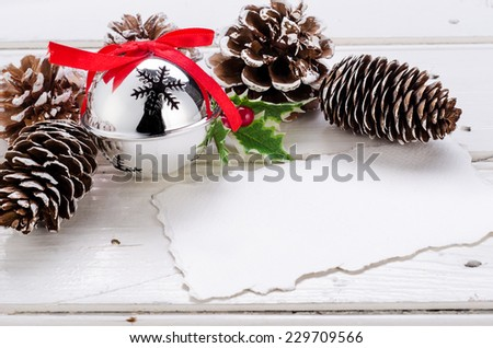 Christmas decorations and cones on wood, with copy space - stock photo