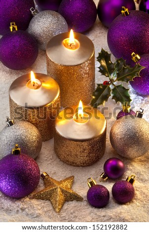 Christmas decorations and festive candles. - stock photo