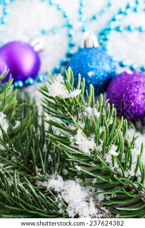 Christmas decorations and fir tree in the snow - stock photo