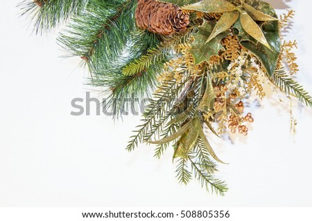 Christmas decorations and fir tree on a white background close up
