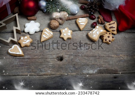 Christmas decorations and home made ginger bread on rustic wooden background  - stock photo