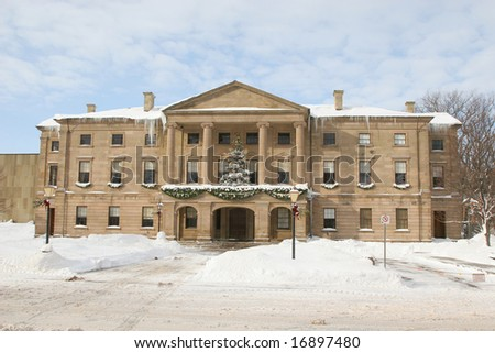 Christmas decorations and lots of snow on Province House in Charlottetown, Prince Edward Island, Canada.
