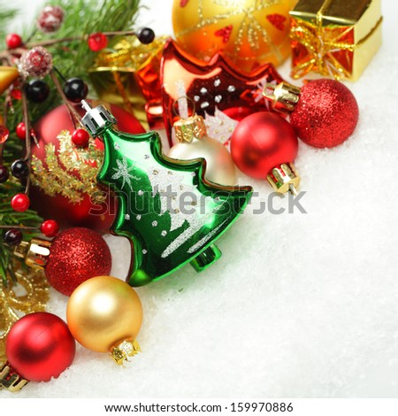 Christmas decorations and Xmas tree on white winter snow background