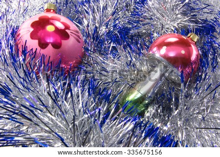 Christmas decorations are surrounded by shiny tinsel - stock photo