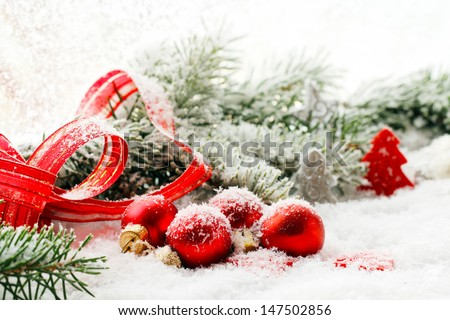 Christmas decorations, balls and ribbon in red - stock photo