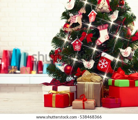 Christmas decorations. Christmas background. Beautiful holiday decorated  room with Christmas tree with presents under