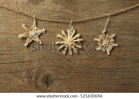 Christmas decorations hanging on a clothesline on a wooden background